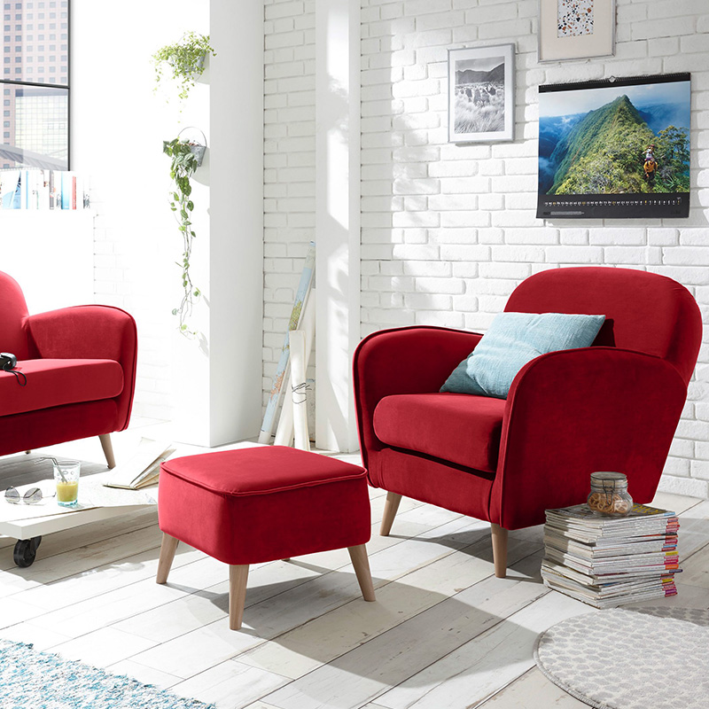 fauteuil rouge repose pied